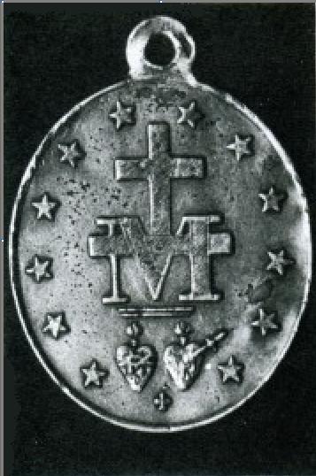 envers grossi de la première frappe de la médaille miraculeuse en 1832 de chez Vachette